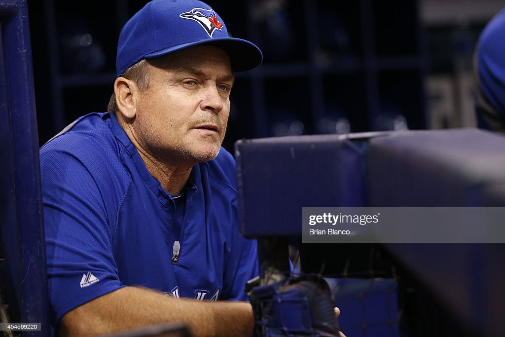 Manager John Gibbons #5 of the Toronto Blue Jays looks on from the dugout moments before the start of a game against the Tampa Bay Rays on September 3, 2014 at Tropicana Field in St. Petersburg, Florida.