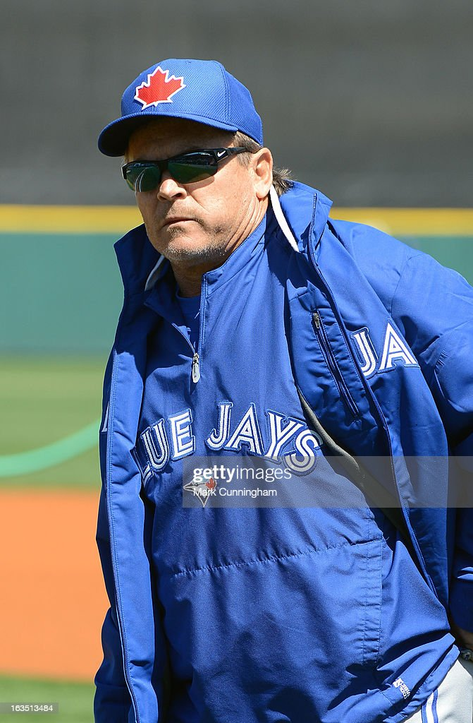 Manager John Gibbons #5 of the Toronto Blue Jays looks on prior to the spring training game against the Detroit Tigers at Joker Marchant Stadium on March 6, 2013 in Lakeland, Florida. The Tigers defeated the Blue Jays 4-1.