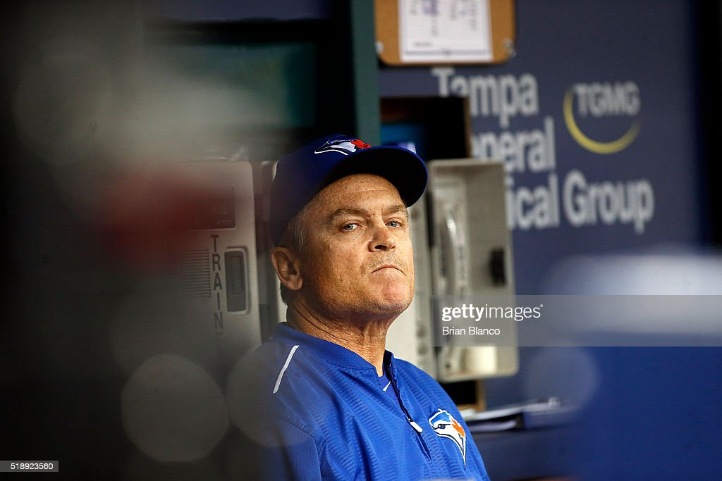 Manager John Gibbons #5 of the Toronto Blue Jays looks out to the field from the dugout before the start of a game against the Tampa Bay Rays on April 3, 2016 at Tropicana Field in St. Petersburg, Florida.