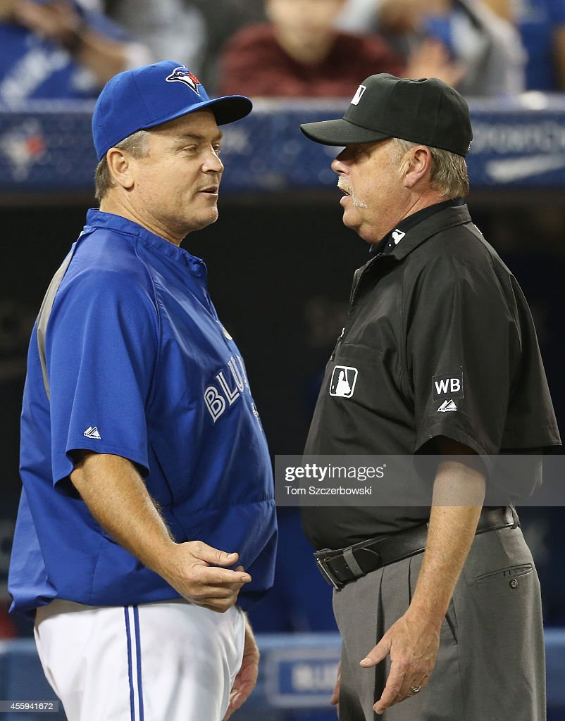 Manager John Gibbons #5 of the Toronto Blue Jays questions a call to first base umpire Jim Joyce #66 at the end of the second inning during MLB game action against the Seattle Mariners on September 22, 2014 at Rogers Centre in Toronto, Ontario, Canada.