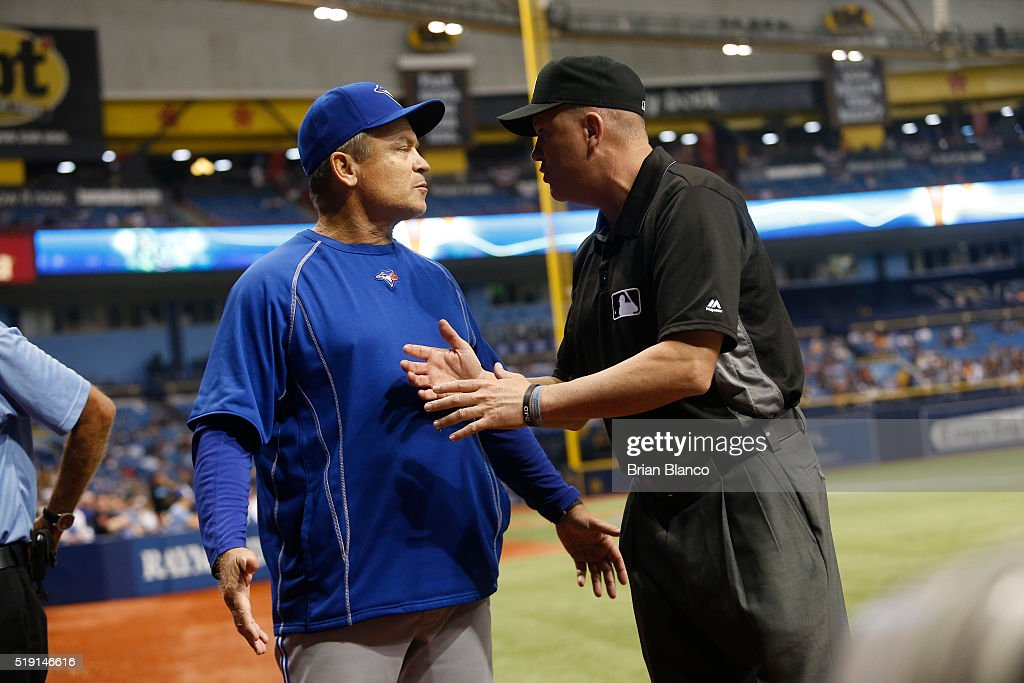 Manager John Gibbons #5 of the Toronto Blue Jays speaks with umpire Mike Everitt #57 after a reviewed play where officials determined that Chris Colabello of the Toronto Blue Jays fouled out to right during the fourth inning of a game on April 4, 2016 at Tropicana Field in St. Petersburg, Florida.