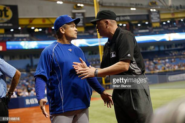 Manager John Gibbons of the Toronto Blue Jays speaks with umpire Mike Everitt after a reviewed play where officials determined that Chris Colabello...