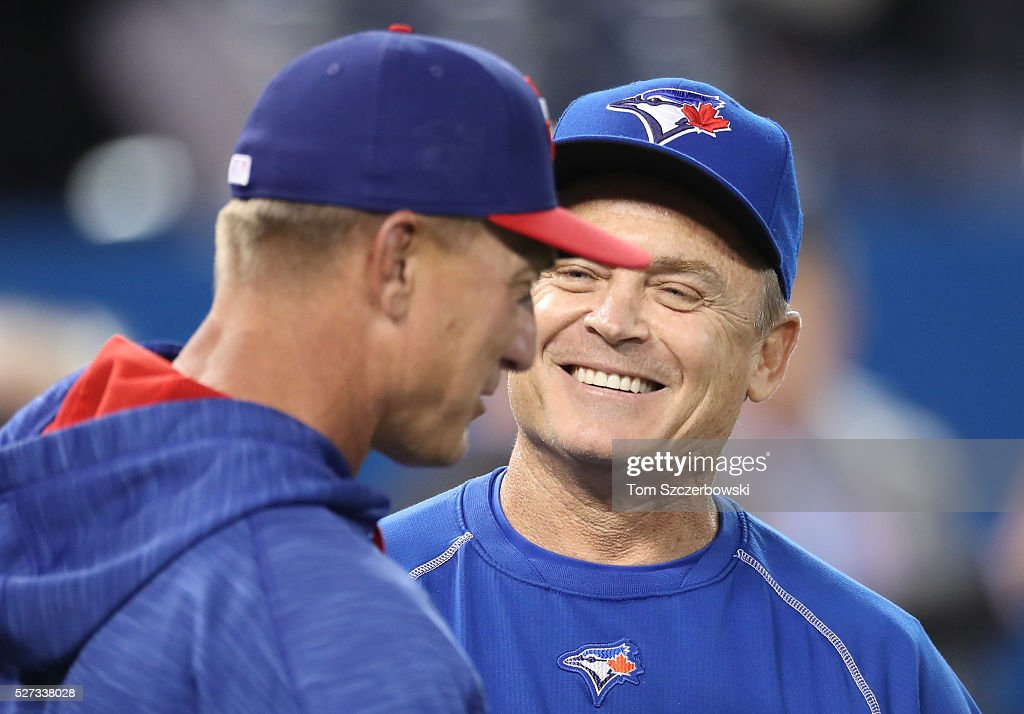 Manager John Gibbons #5 of the Toronto Blue Jays talks to manager Jeff Bannister #28 of the Texas Rangers before the start of their MLB game on May 2, 2016 at Rogers Centre in Toronto, Ontario, Canada.