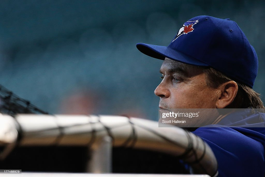 Manager John Gibbons #5 of the Toronto Blue Jays waits on the field before the game against the Houston Astros at Minute Maid Park on August 23, 2013 in Houston, Texas.