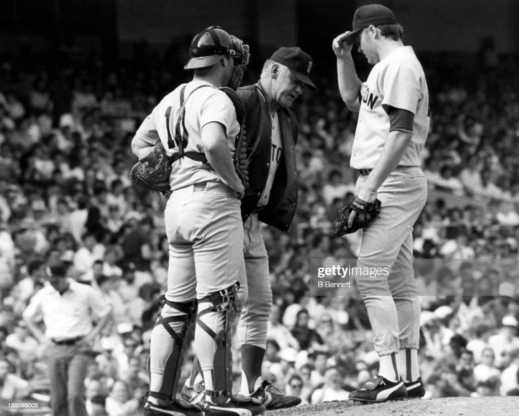 Manager John McNamara visits the mound to talk with pitcher Roger Clemens #21 and catcher Rich Gedman #10 of the Boston Red Sox during their game circa 1987.