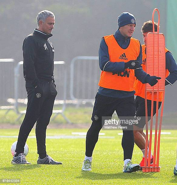 Manager Jose Mourinho and Bastian Schweinsteiger of Manchester United in action during a first team training session at Aon Training Complex on...