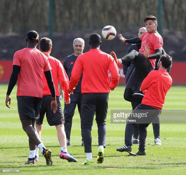 Manager Jose Mourinho and Marcos Rojo of Manchester United in action during a first team training session at Aon Training Complex on March 15 2017 in...