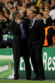 Manager Jose Mourinho gestures to Harry Redknapp of Spurs during the UEFA Champions League quarter final second leg match between Tottenham Hotspur...