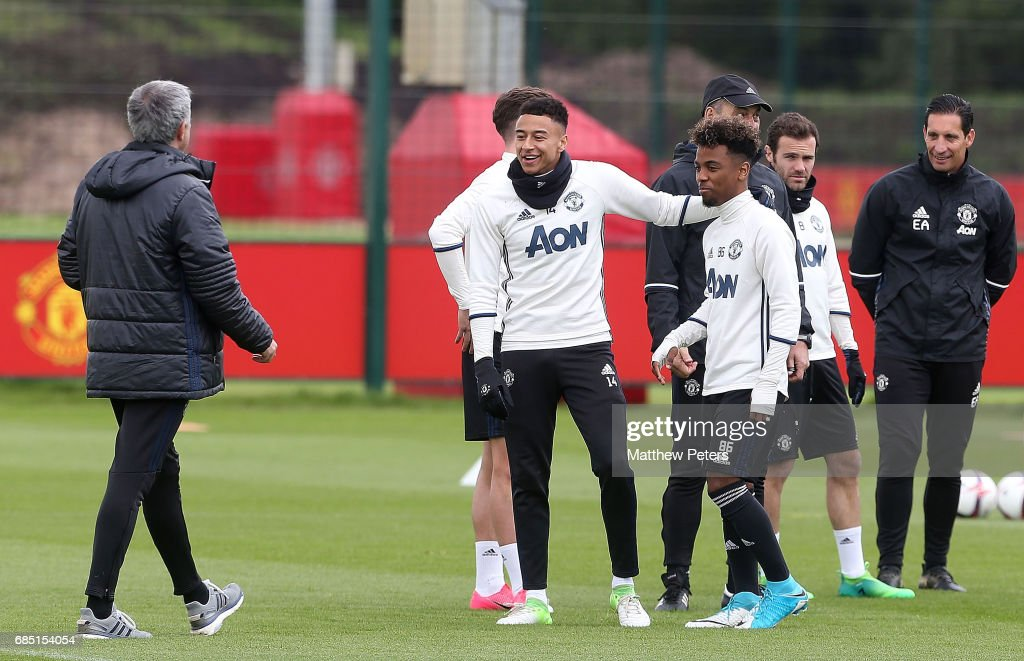 Manager Jose Mourinho, Jesse Lingard and Angel Gomes of Manchester United in action during a first team training session at Aon Training Complex on May 19, 2017 in Manchester, England.