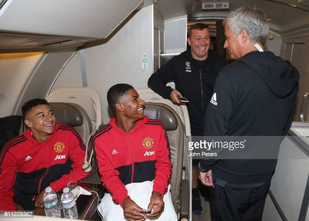 Manager Jose Mourinho Jesse Lingard and Marcus Rashford sit on the aeroplane ahead of the club's preseason tour of the USA at Manchester Airport on...