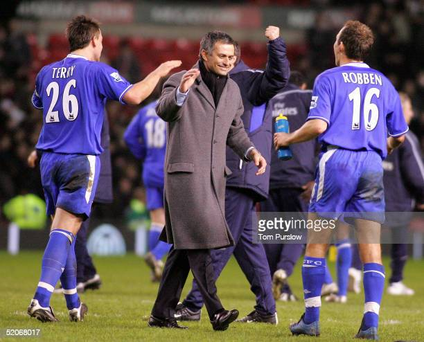Manager Jose Mourinho John Terry and Arjen Robben of Chelsea celebrate at the final whistle of the Carling Cup semifinal second leg between...