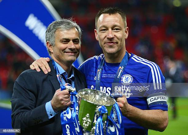 Manager Jose Mourinho of Chelsea and John Terry of Chelsea pose with the trophy during the Capital One Cup Final match between Chelsea and Tottenham...