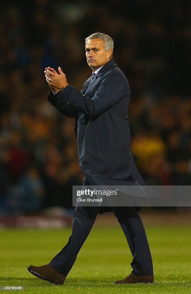 Manager Jose Mourinho of Chelsea applauds at the final whistle during the Barclays Premier League match between Burnley and Chelsea at Turf Moor on August 18, 2014 in Burnley, England.