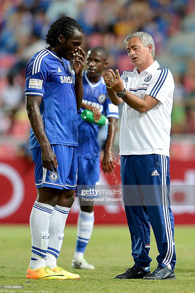 Manager Jose Mourinho of Chelsea FC talking with Romelu Lukaku during the international friendly match between Chelsea FC and the Singha Thailand All-Star XI on July 17, 2013 in Bangkok, Thailand.