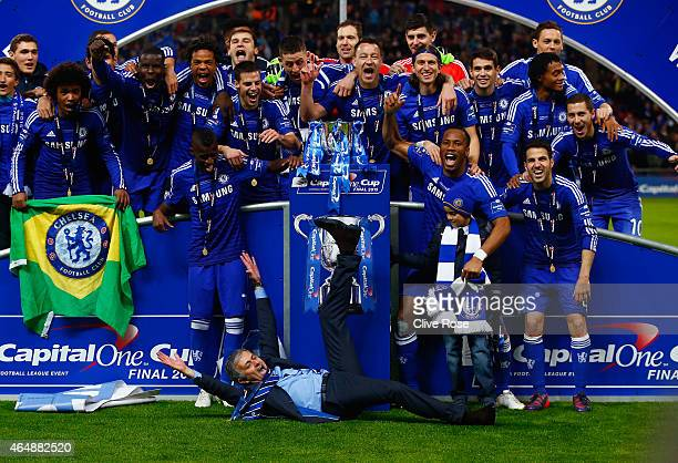 Manager Jose Mourinho of Chelsea lies on the pitch as Chelsea celebrate with the trophy during the Capital One Cup Final match between Chelsea and...