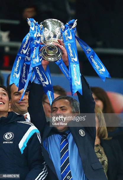 Manager Jose Mourinho of Chelsea lifts the trophy during the Capital One Cup Final match between Chelsea and Tottenham Hotspur at Wembley Stadium on...