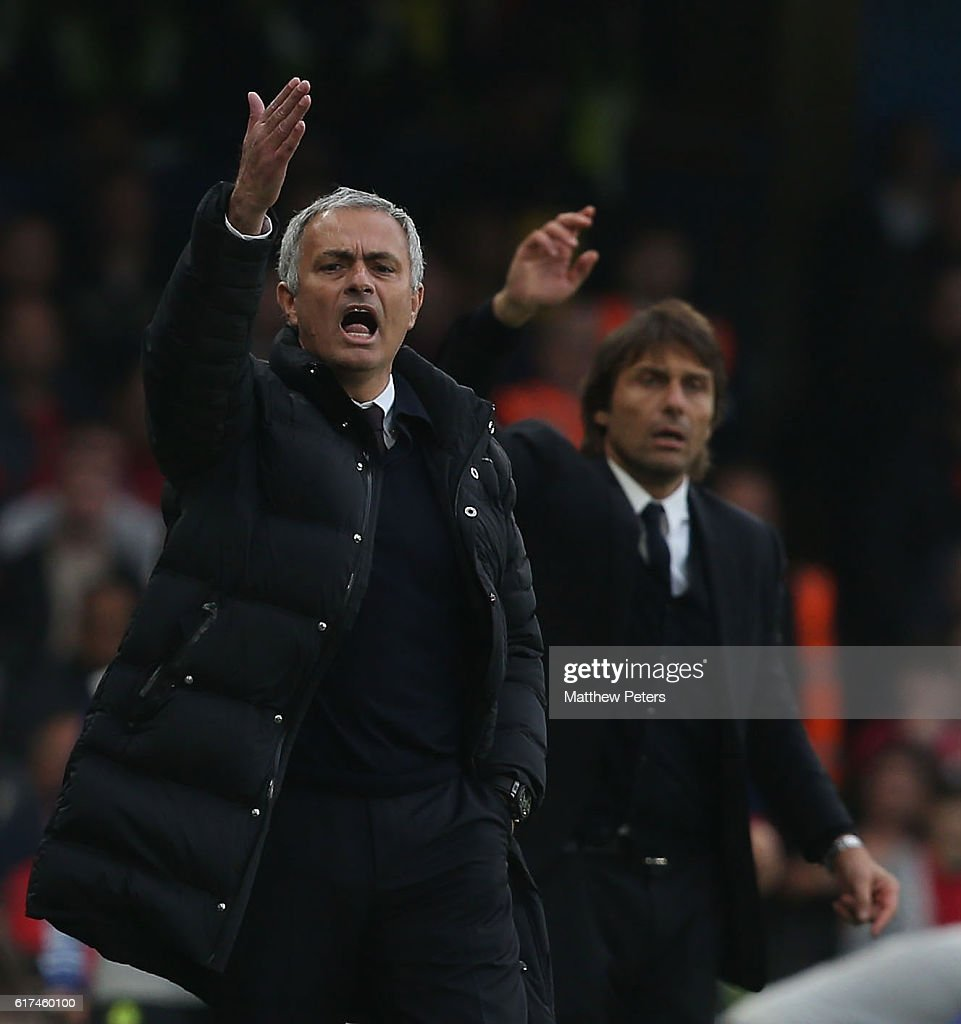 Manager Jose Mourinho of Manchester United and Manager Antonio Conte of Chelsea watch from the touchline during the Premier League match between Chelsea and Manchester United at Stamford Bridge on October 23, 2016 in London, England.
