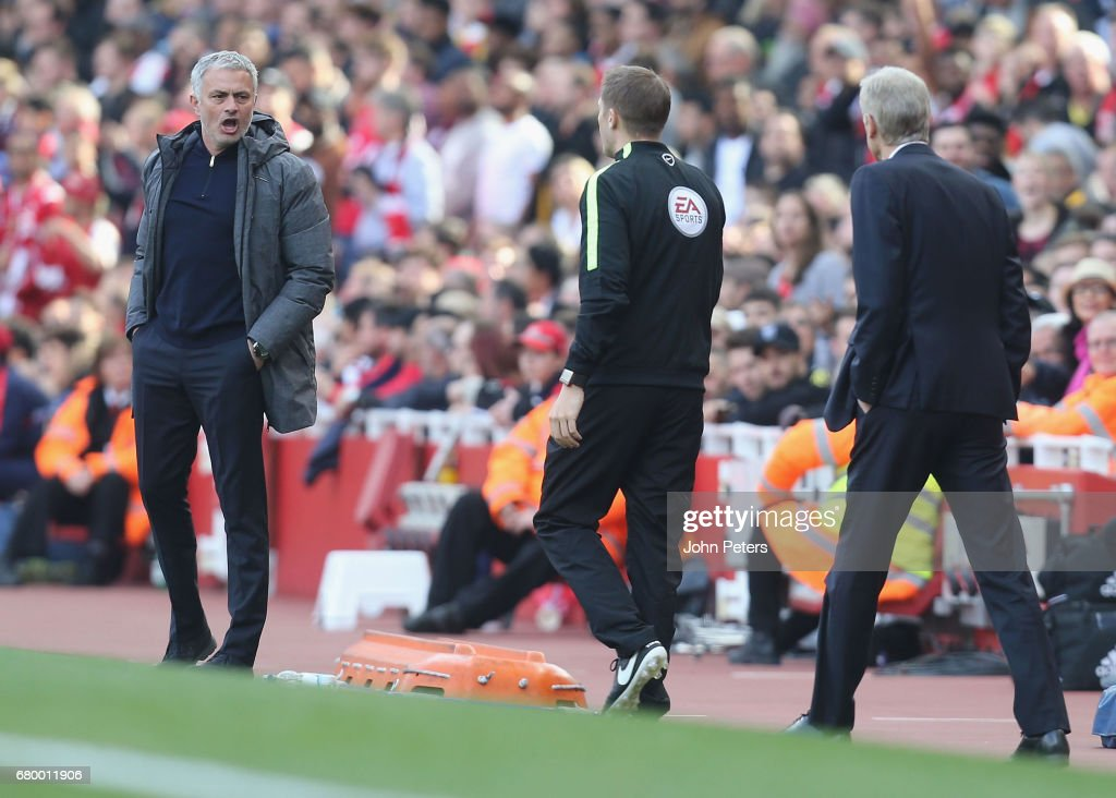 Manager Jose Mourinho of Manchester United and Manager Arsene Wenger of Arsenal speak to the fourth official during the Premier League match between Manchester United and Arsenal at Emirates Stadium on May 7, 2017 in London, England.
