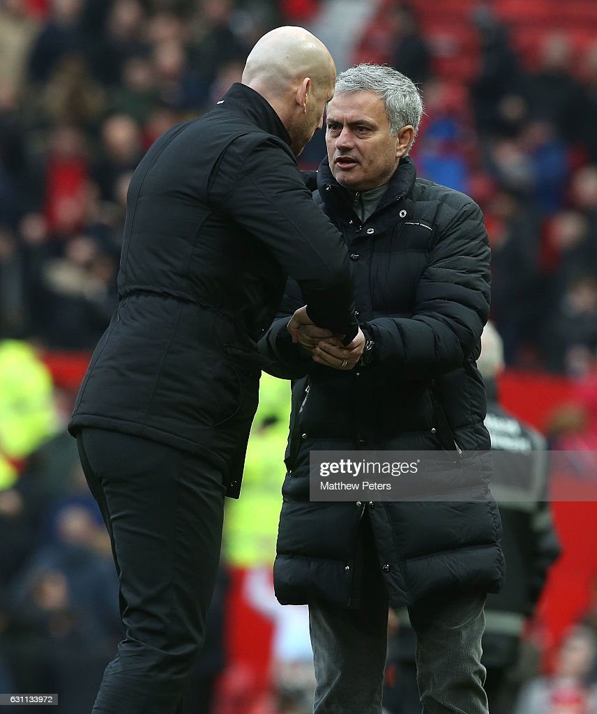 Manager Jose Mourinho of Manchester United and Manager Jaap Stam of Reading shake hands after the Emirates FA Cup Third Round match between Manchester United and Reading at Old Trafford on January 7, 2017 in Manchester, England.