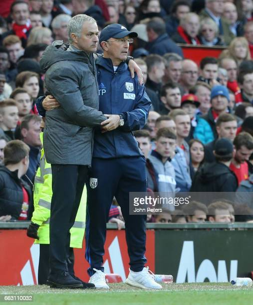 Manager Jose Mourinho of Manchester United and Manager Tony Pulis of West Bromwich Albion watch from the touchline during the Premier League match...