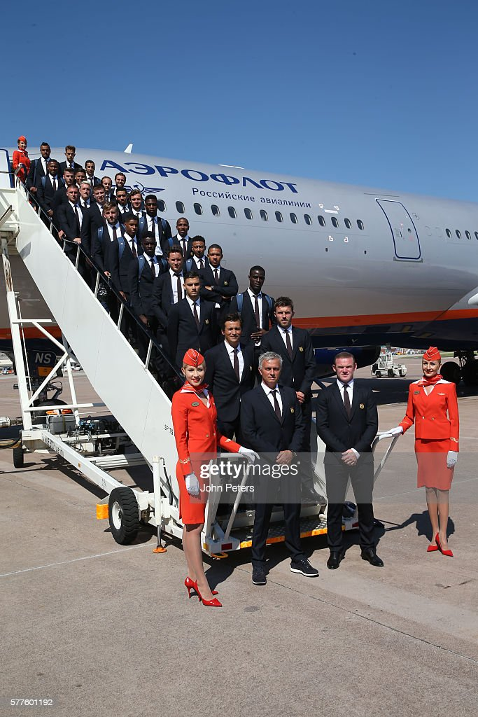 Manager Jose Mourinho of Manchester United captain Wayne Rooney and the Manchester United squad pose on the stairs of an aircraft ahead of their...