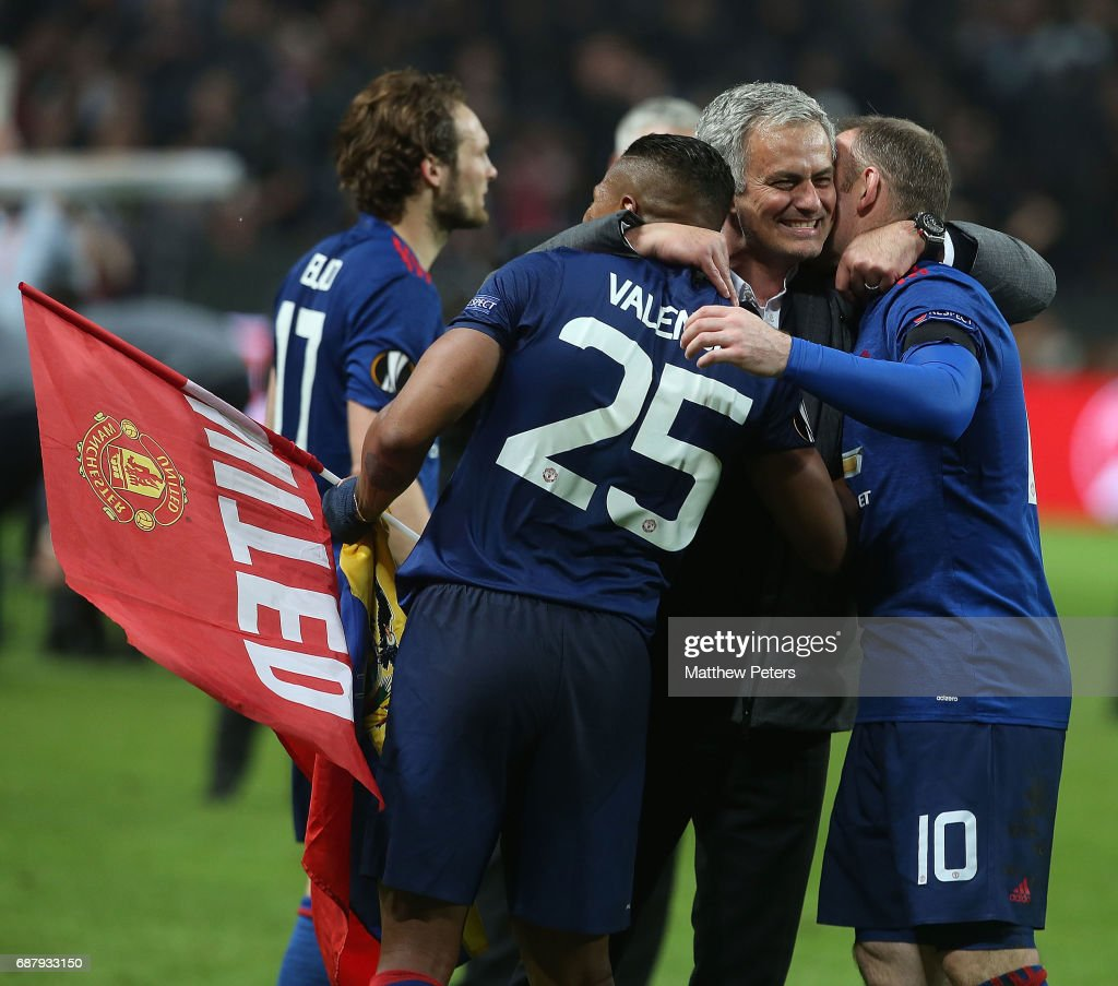 Manager Jose Mourinho of Manchester United celebrates with Antonio Valencia and Wayne Rooney after the UEFA Europa League Final match between Manchester United and Ajax at Friends Arena on May 24, 2017 in Stockholm, Sweden.