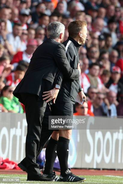Manager Jose Mourinho of Manchester United collides with the fourth official leading him to be sent off during the Premier League match between...