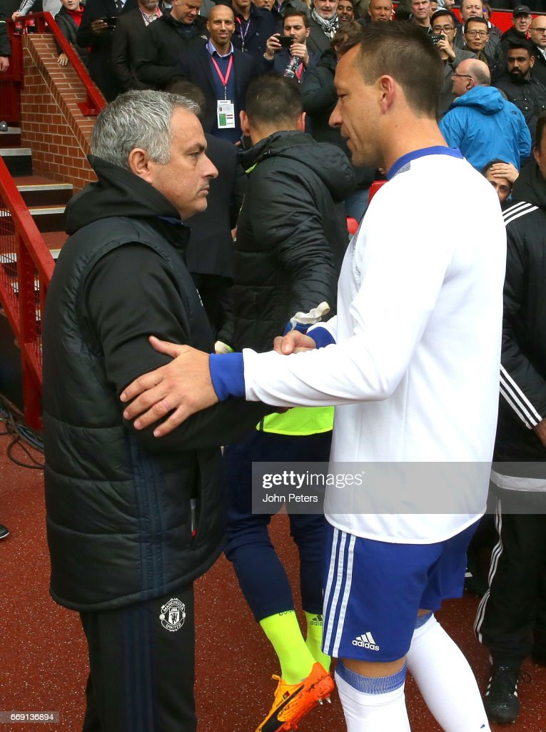 Manager Jose Mourinho of Manchester United greets John Terry of Chelsea ahead of the Premier League match between Manchester United and Chelsea at Old Trafford on April 16, 2017 in Manchester, England.