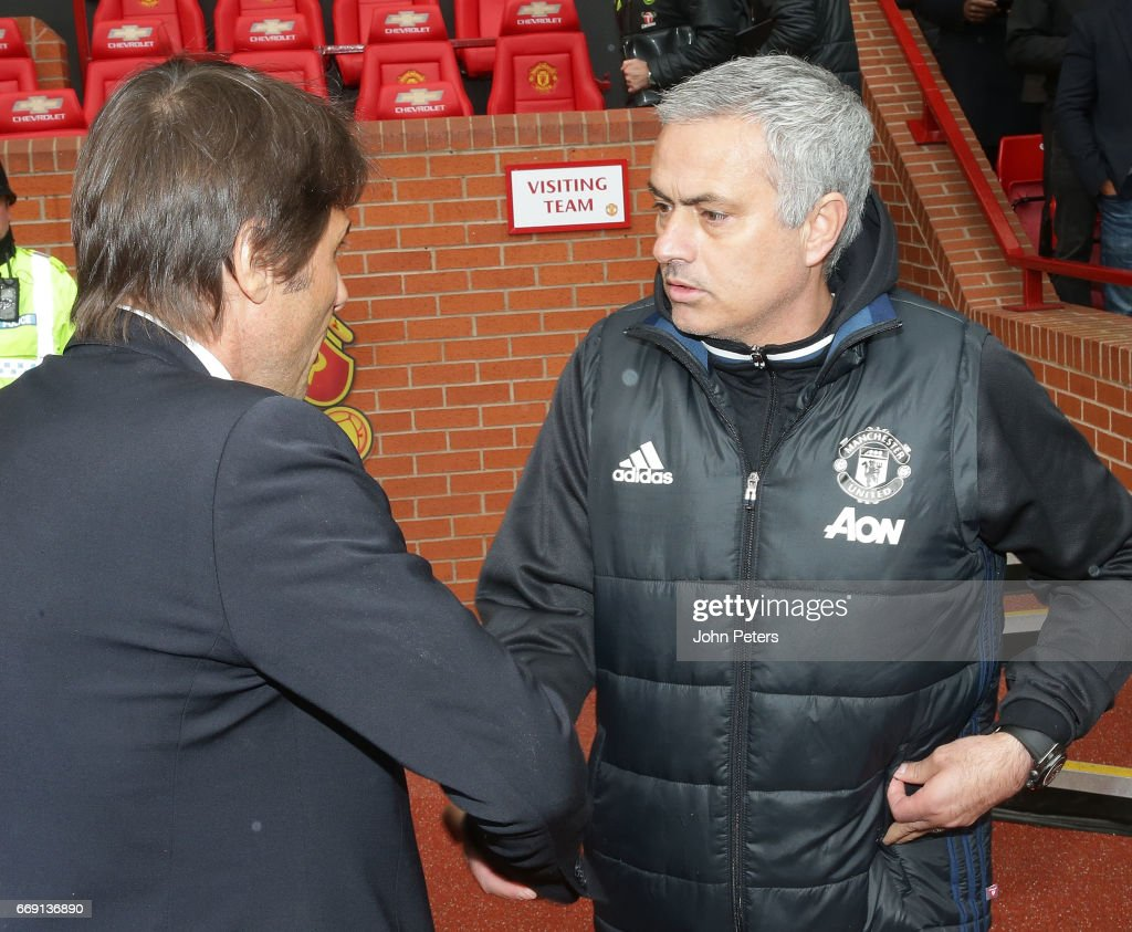 Manager Jose Mourinho of Manchester United greets Manager Antonio Conte of Chelsea ahead of the Premier League match between Manchester United and Chelsea at Old Trafford on April 16, 2017 in Manchester, England.