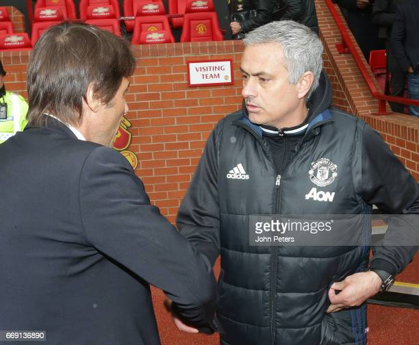 Manager Jose Mourinho of Manchester United greets Manager Antonio Conte of Chelsea ahead of the Premier League match between Manchester United and...