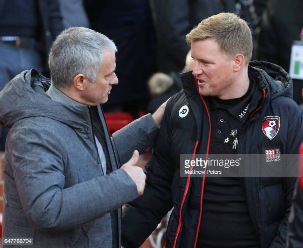 Manager Jose Mourinho of Manchester United greets Manager Eddie Howe of AFC Bournemouth ahead of the Premier League match between Manchester United...