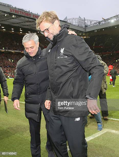 Manager Jose Mourinho of Manchester United greets Manager Jurgen Klopp of Liverpool ahead of the Premier League match between Manchester United and...