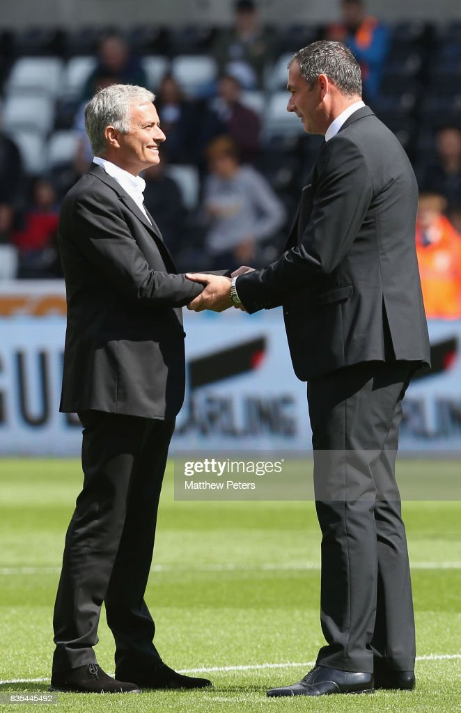 Manager Jose Mourinho of Manchester United greets Manager Paul Clement of Swansea City ahead of the Premier League match between Swansea City and Manchester United at Liberty Stadium on August 19, 2017 in Swansea, Wales.