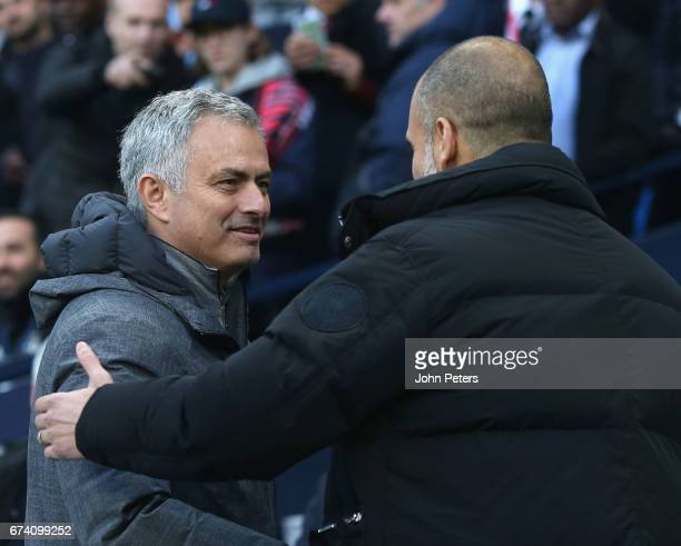 Manager Jose Mourinho of Manchester United greets Manager Pep Guardiola of Manchester City ahead of the Premier League match between Manchester City...