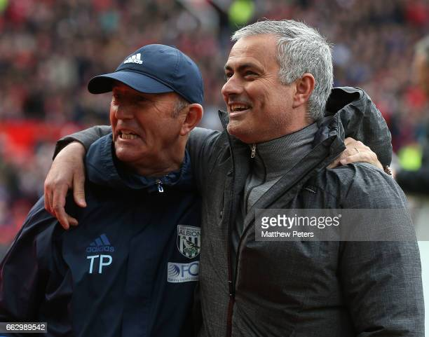 Manager Jose Mourinho of Manchester United greets Manager Tony Pulis of West Bromwich Albion ahead of the Premier League match between Manchester...