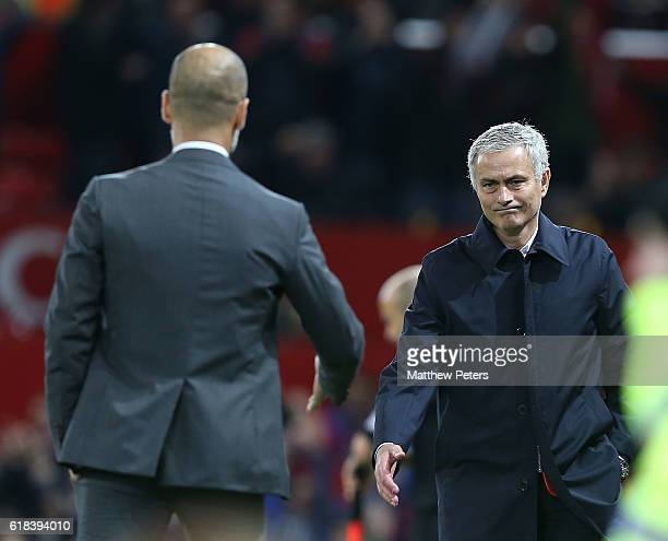 Manager Jose Mourinho of Manchester United shakes hands with Manager Pep Guardiola of Manchester City after the EFL Cup Fourth Round match between...