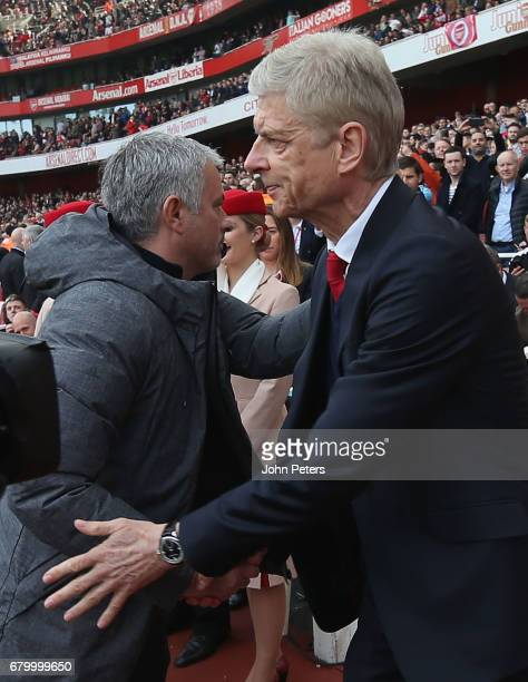 Manager Jose Mourinho of Manchester United shakes hands with Manager Arsene Wenger of Arsenal ahead of the Premier League match between Manchester...