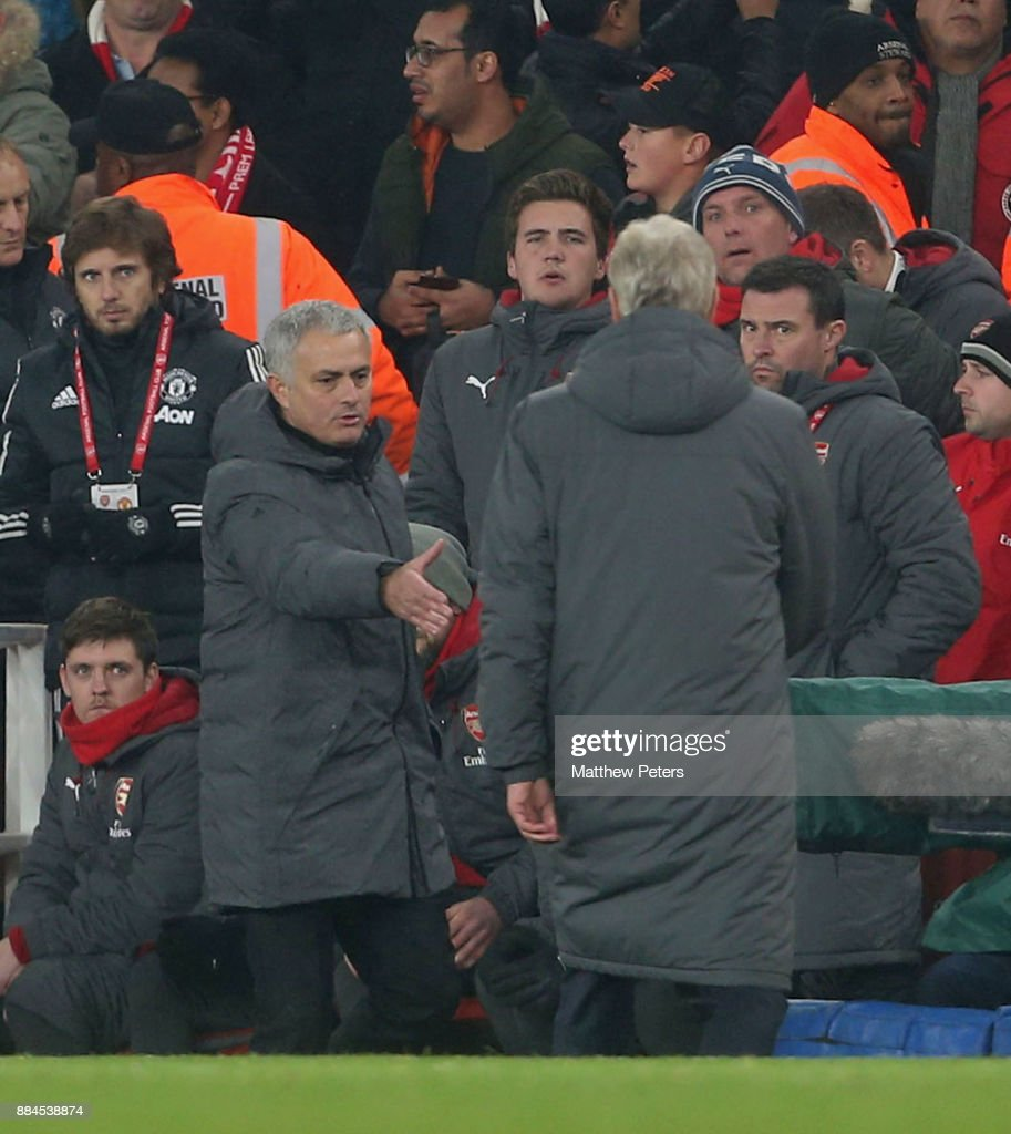 Manager Jose Mourinho of Manchester United shakes hands with Manager Arsene Wenger of Arsenal after the Premier League match between Arsenal and Manchester United at Emirates Stadium on December 2, 2017 in London, England.