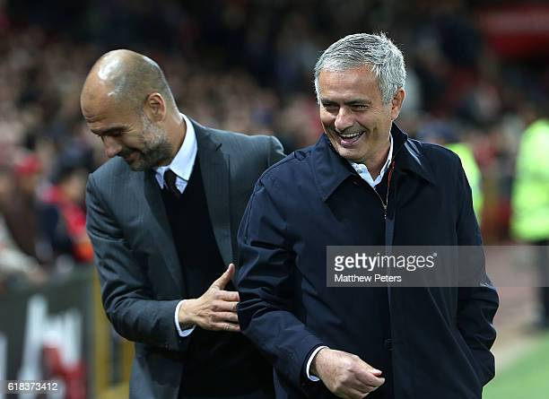 Manager Jose Mourinho of Manchester United shares a joke with Manager Pep Guardiola of Manchester City ahead of the EFL Cup Fourth Round match...