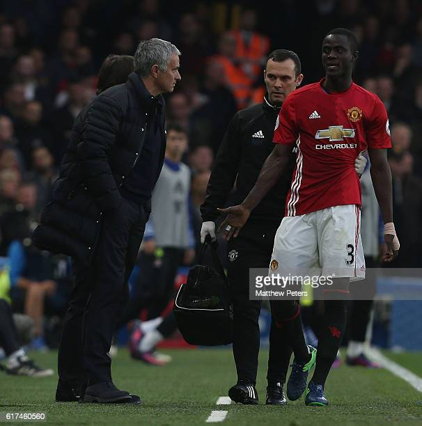 Manager Jose Mourinho of Manchester United speaks to Eric Bailly after he left the match with an injury during the Premier League match between...