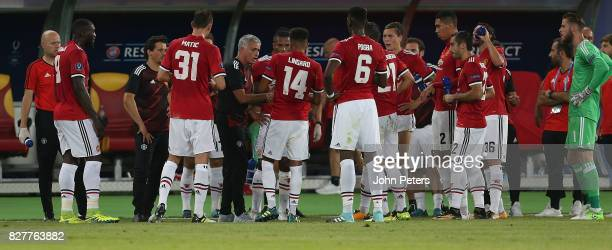 Manager Jose Mourinho of Manchester United speaks to his team during a drinks break during the UEFA Super Cup match between Real Madrid and...