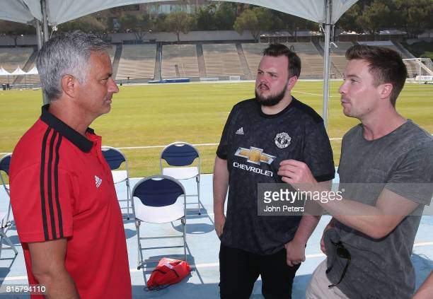 Manager Jose Mourinho of Manchester United talks with Game of Thrones actors John BradleyWest and Joe Dempsie ahead of a first team training session...