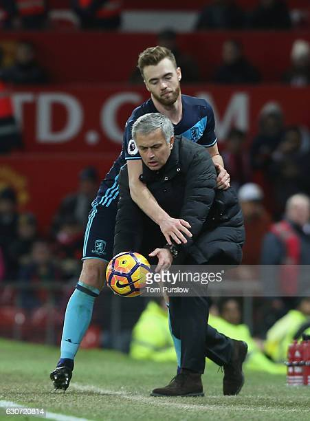 Manager Jose Mourinho of Manchester United tussles with Calum Chambers of Middlesbrough during the Premier League match between Manchester United and...