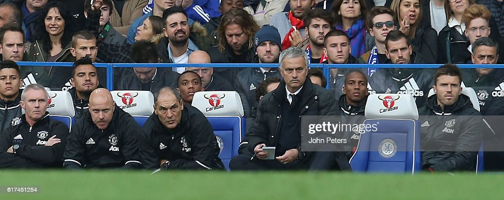 Manager Jose Mourinho of Manchester United watches from the dugout during the Barclays Premier League match between Chelsea and Manchester United at Stamford Bridge on October 23, 2016 in London, England.