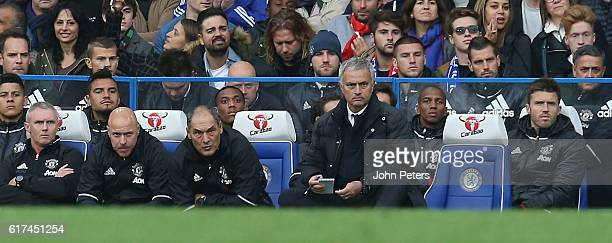 Manager Jose Mourinho of Manchester United watches from the dugout during the Barclays Premier League match between Chelsea and Manchester United at...