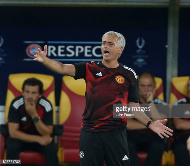 Manager Jose Mourinho of Manchester United watches from the dugout during the UEFA Super Cup match between Real Madrid and Manchester United at...