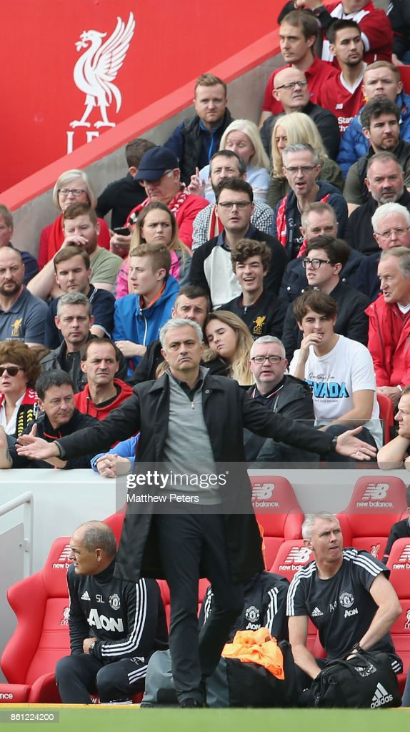 Manager Jose Mourinho of Manchester United watches from the touchline during the Premier League match between Liverpool and Manchester United at Anfield on October 14, 2017 in Liverpool, England.