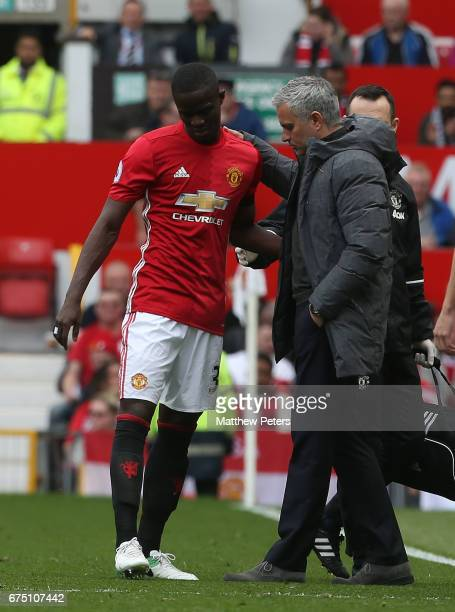 Manager Jose Mourinho speaks to Eric Bailly of Manchester United after the defender was forced off injured during the Premier League match between...