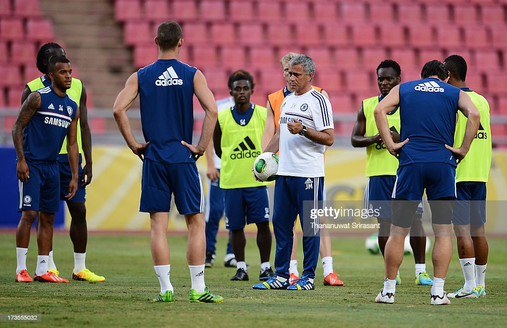 Manager Jose Mourinho speaks to players during a Chelsea FC training session at Rajamangala Stadium on July 16, 2013 in Bangkok, Thailand.