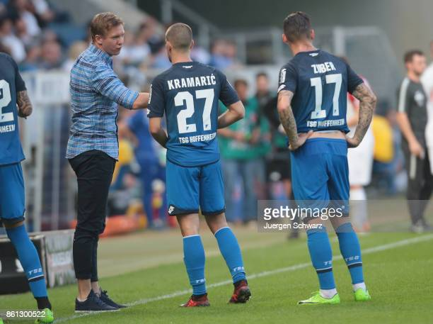 Manager Julian Nagelsmann hl talks to Andrej Kramaric and Steven Zuber during the Bundesliga match between TSG 1899 Hoffenheim and FC Augsburg at...